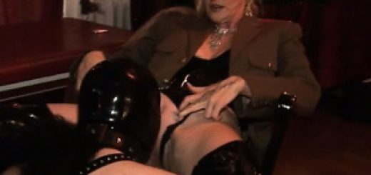 kinky-mistress-puts-a-plug-in-her-male-slaves-ass_01